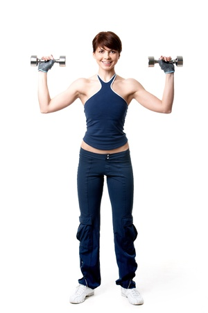 Image of smiling woman exercising with barbells in hands photo