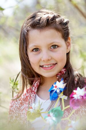 cute braces: Portrait of cute girl with toy looking at camera outdoors