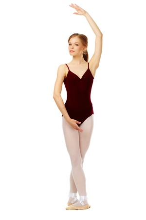 Portrait of charming ballet dancer on white looking at camera photo