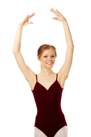 Portrait of charming ballerina with raised arms looking at camera photo