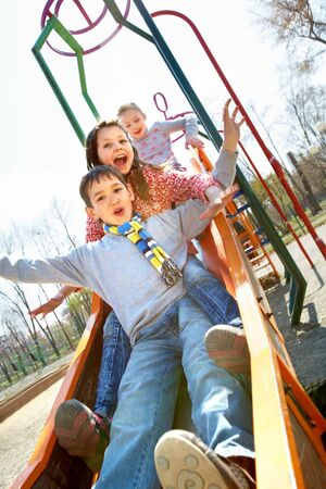 Portrait of happy children having fun outside Stock Photo - 9821792