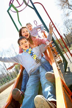 Portrait of happy children having fun outside photo