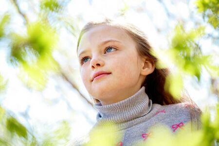 innocent: Portrait of calm girl looking upwards in natural environment