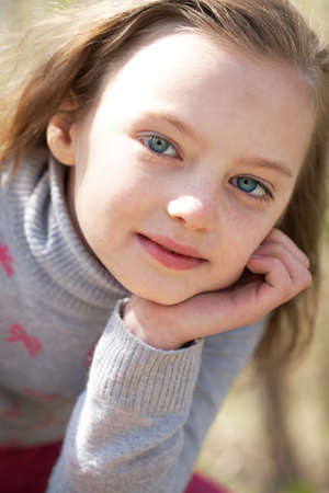 Portrait of cute girl looking at camera in natural environment photo