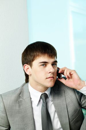 Portrait of handsome man calling by mobile phone photo