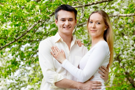 Portrait of young couple looking at camera in park Stock Photo - 9807294
