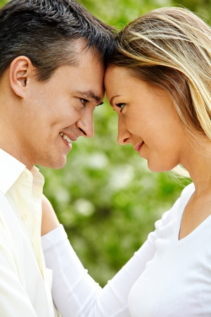 Portrait of young couple looking at each other outdoors photo