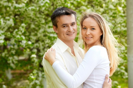 Portrait of young couple looking at camera in park photo