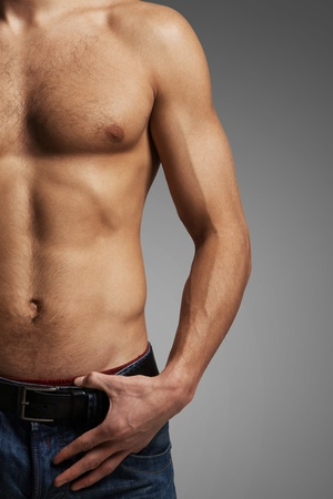 Image of handsome man with bare torso posing before camera photo