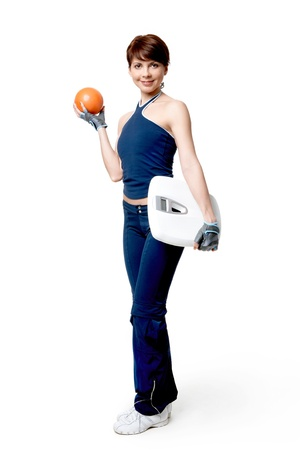 Image of smiling woman with ball and electronic scales looking at camera over white background Stock Photo - 9812969