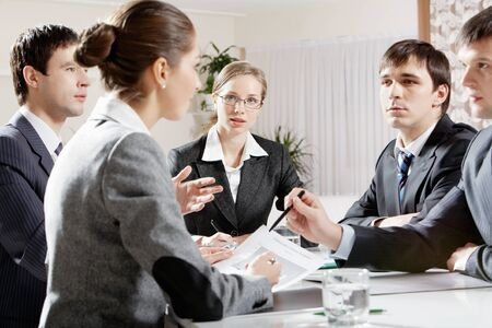 Portrait of colleagues planning their work and discussing it in office Stock Photo - 9821821