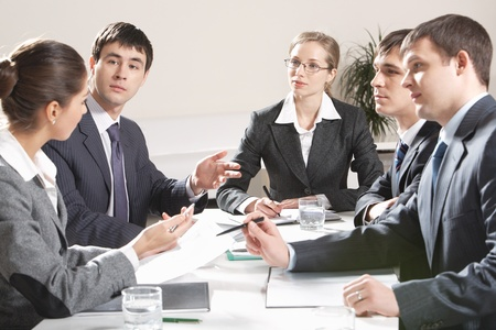Portrait of colleagues planning their work and discussing it in office photo