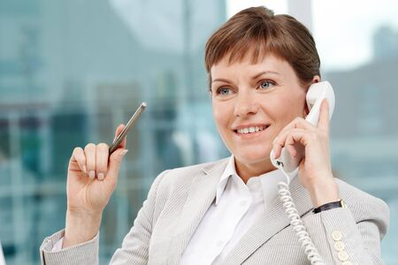 Photo of smart businesswoman calling and smiling Stock Photo - 9807252