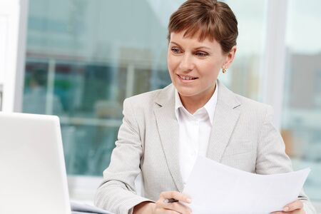 Photo of smart businesswoman working in office photo
