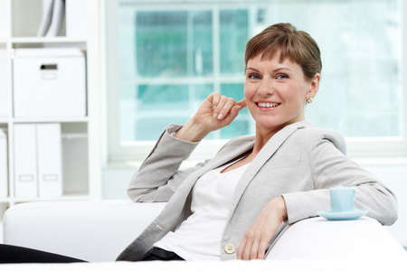 Portrait of smiling businesswoman looking at camera in office photo