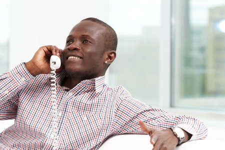 Image of friendly businessman talking by the phone Stock Photo - 9807291