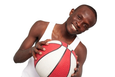 Image of a basketball player with ball looking at camera photo