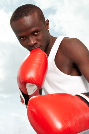 Image of a boxer in red gloves ready to attack his rival photo
