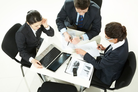 Image of business partners planning work at meeting photo