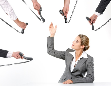 Photo of businesswoman going to take telephone receiver while being offered several of them  photo
