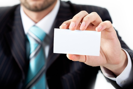 Close-up of businessman showing blank visiting card in his hand photo