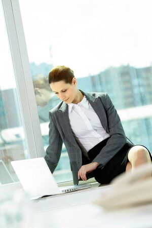 Photo of smart businesswoman working with laptop in office Stock Photo - 9817868