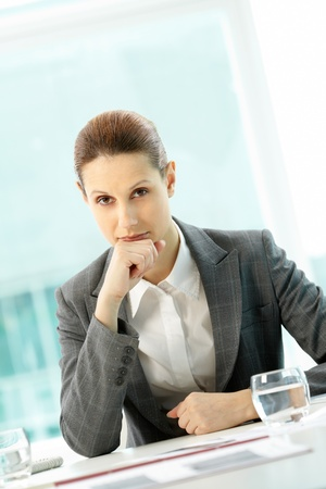Portrait of pensive businesswoman looking at camera  photo