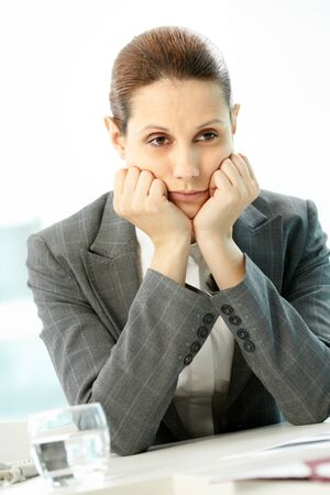 Portrait of pensive businesswoman touching her face  photo