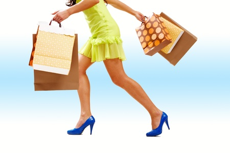 Legs of lady with colorful paper bags in move Stock Photo - 9804348