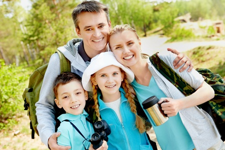 Portrait of family of travelers looking at camera in summer Stock Photo - 9819631