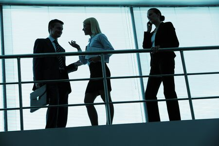 Three outlines of business partners interacting in office photo