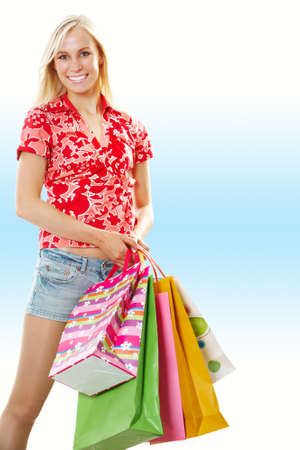 Portrait of a girl with shopping bags isolated on white Stock Photo - 9817851