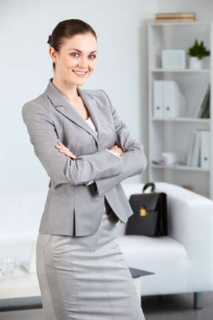 Portrait of smiling businesswoman looking at camera in office Stock Photo - 9819962