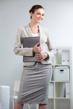 Portrait of smiling businesswoman looking at camera in office Stock Photo - 9819949