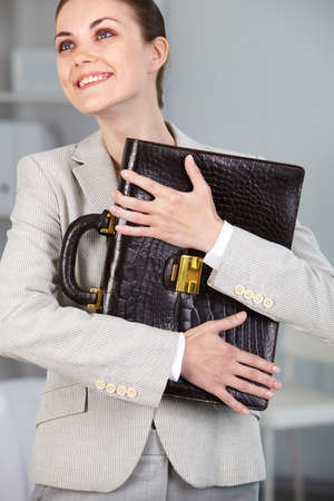 Portrait of smiling businesswoman with briefcase Stock Photo - 9820038