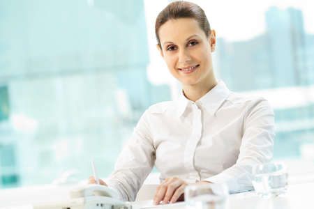 Photo of smiling businesswoman looking at camera photo