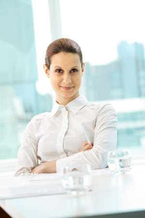 Photo of pretty businesswoman looking at camera with smile photo