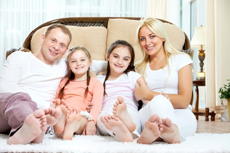 adult sisters: Portrait of happy family with two children sitting at home