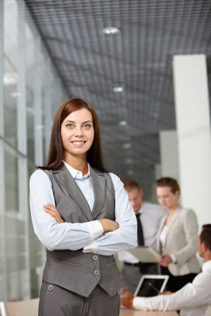 A beautiful businesswoman looking at camera in working environment photo