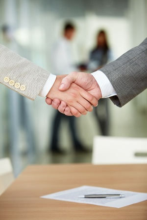 great deal: Photo of handshake of business partners after signing contract