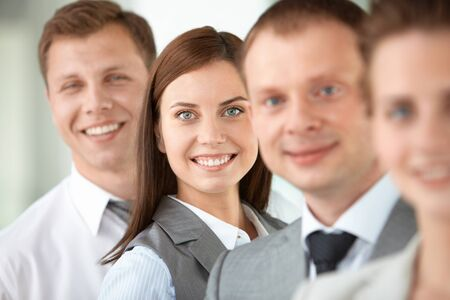 Portrait of friendly leader looking at camera between employees Stock Photo - 9819270