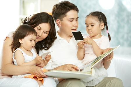 Portrait of happy family with two children spending time at home Stock Photo - 9819559