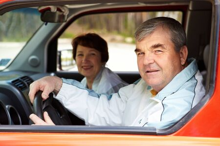 Senior man looking at camera in the car with his wife on background Stock Photo - 9818776