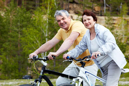 Portrait of happy mature couple on bicycles Stock Photo - 9818909