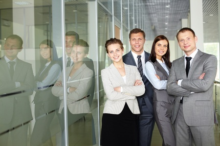Row of confident business group looking at camera  photo