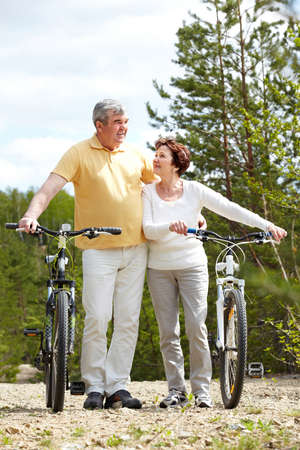 Portrait of mature couple with bicycles on weekend Stock Photo - 9819018