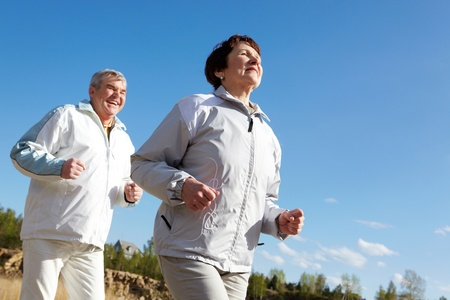 healthy seniors: Portrait of happy mature couple running together