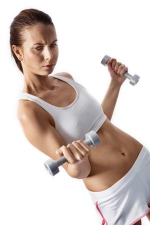 haciendo ejercicio: Imagen de mujer fit haciendo ejercicio con pesas en manos