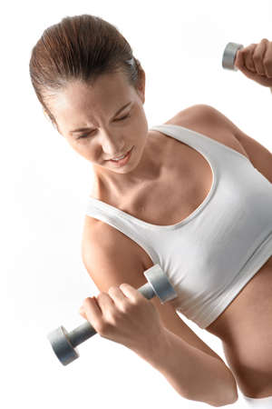 Image of fit woman doing exercise with barbell in hand photo