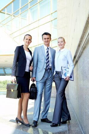 Group of friendly partners looking at camera outside Stock Photo - 9819296